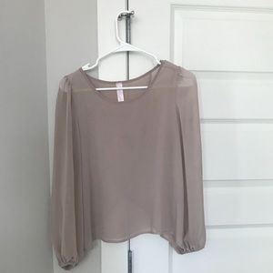 Sheer pink-beige wrap back blouse